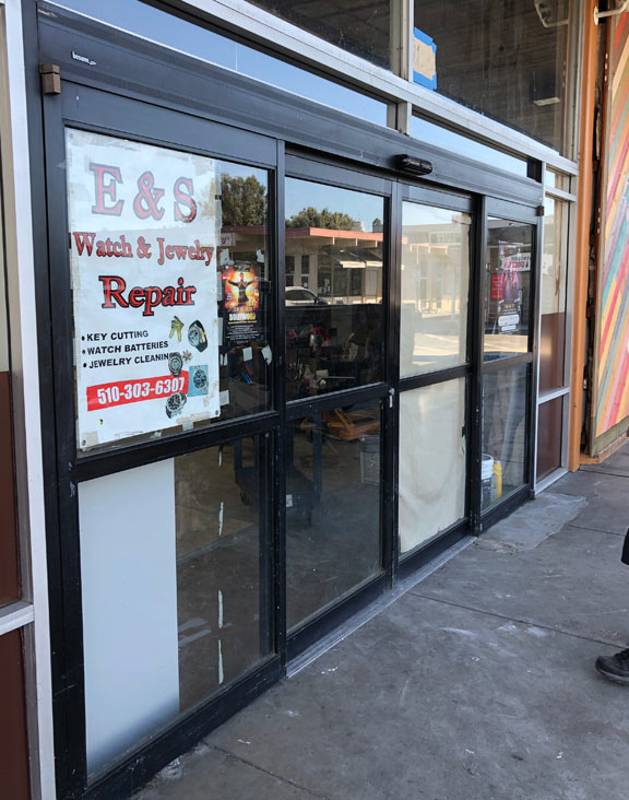 automatic door installation with black framing in Fremont