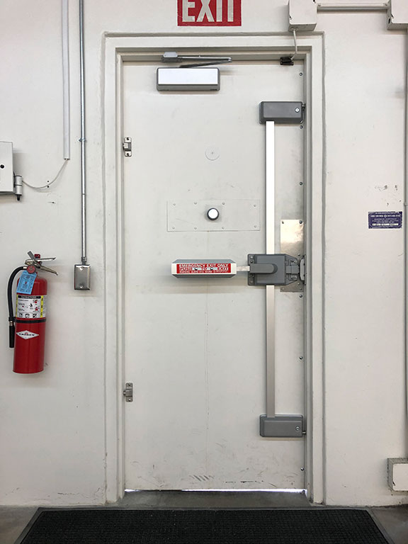 Fire rated door with extinguisher, exit sign, and industrial strength push bar