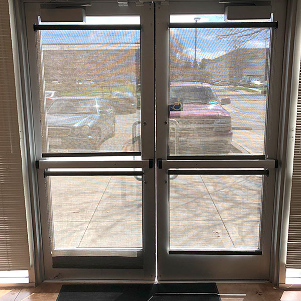 manual storefront door successfully repaired