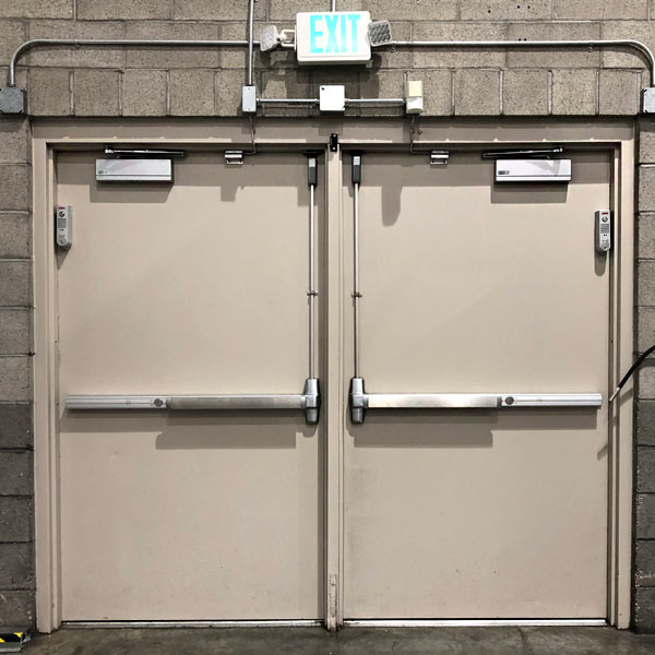 Metal double door with closers and push bars installed in a business in Livermore