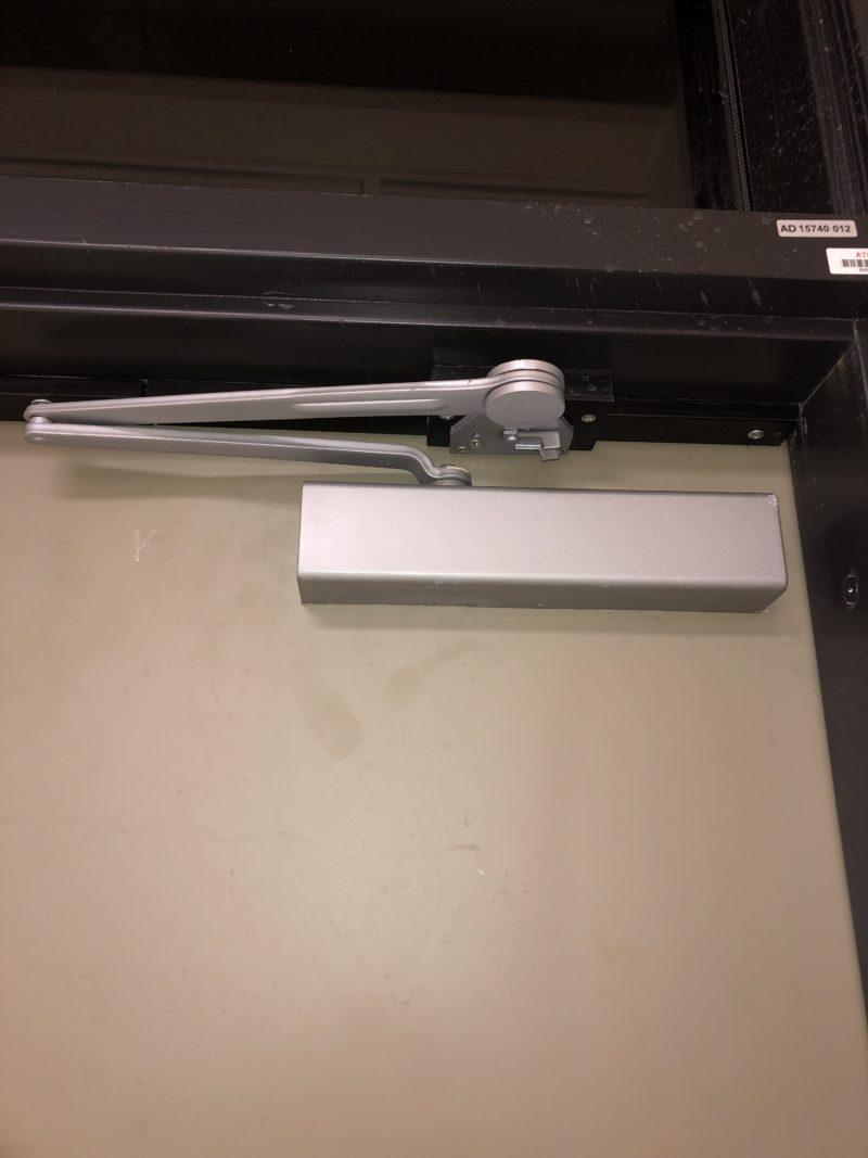 Close up of commercial door operator installed in Jackson