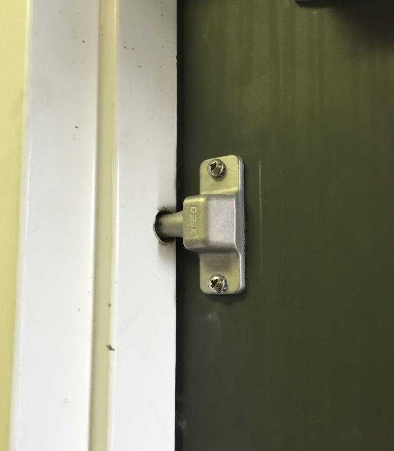 commercial locksmith services repairing a deadbolt door