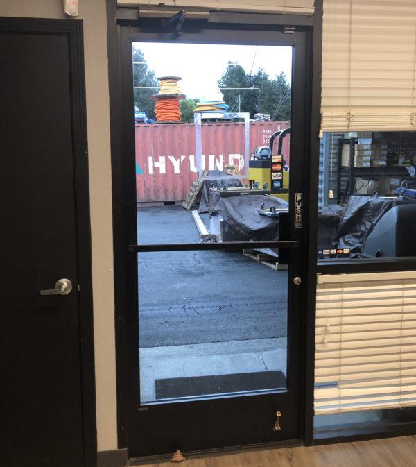 Glass metal door installed on office building in Jackson, California