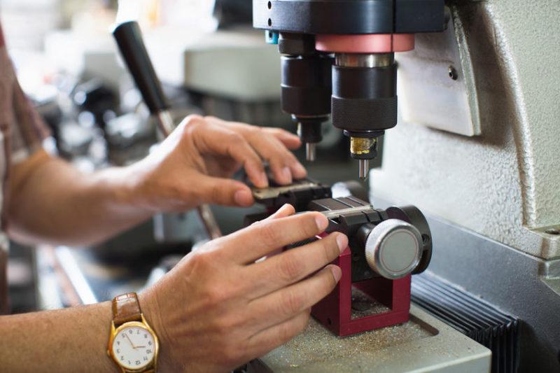 locksmith cuts a new key